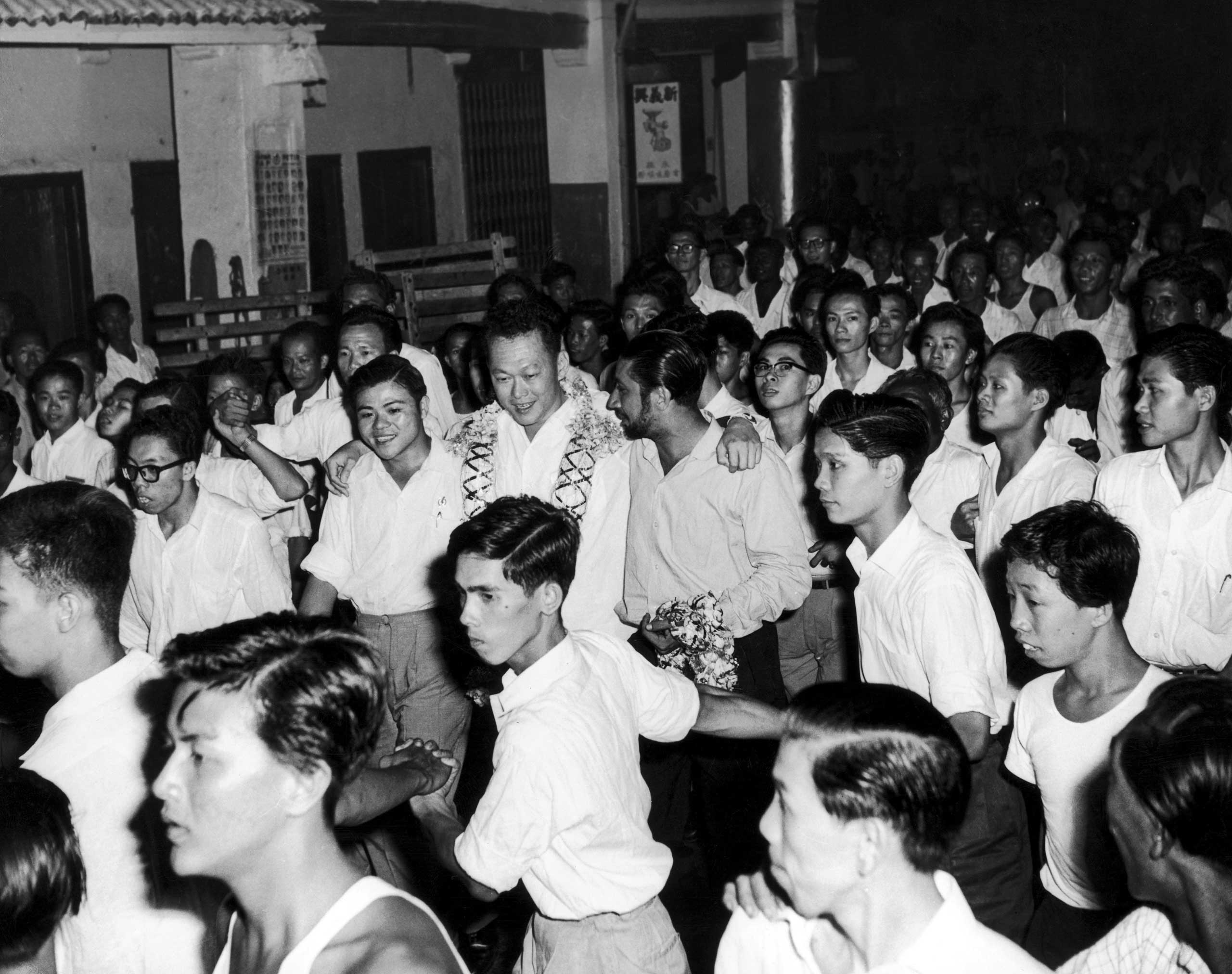 The General Secretary of People's Action Party of Singapore and the new Prime Minister Lee Kuan Yew congratulated by his supporters in 1959.