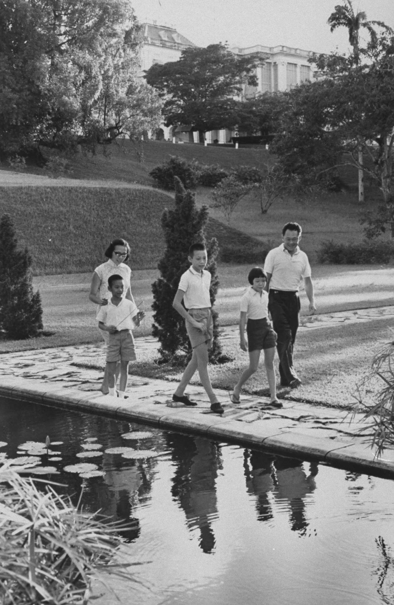 """Prime Minister Lee Kuan Yew and family at official residence of """"Sri Tamasek"""" in 1965."""