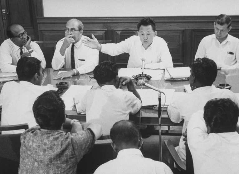 Prime Minister Kuan Yew Lee in conference with Labor leaders during strike threat in 1965.