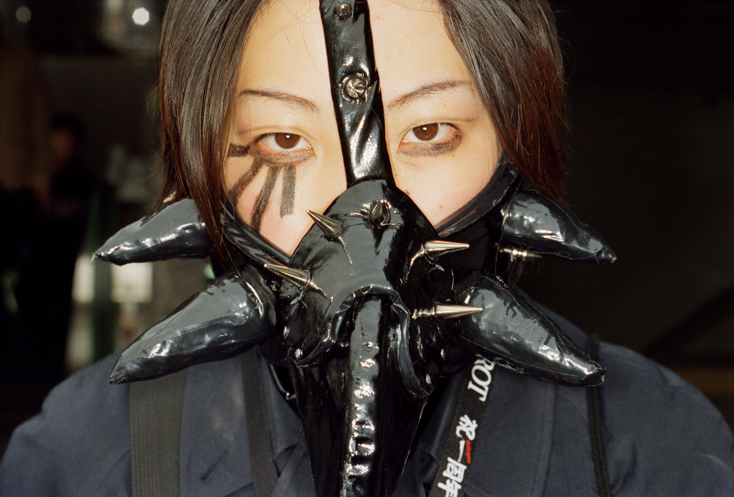 Teenage girl wearing a black dominatrix mask. Tokyo, 2000.