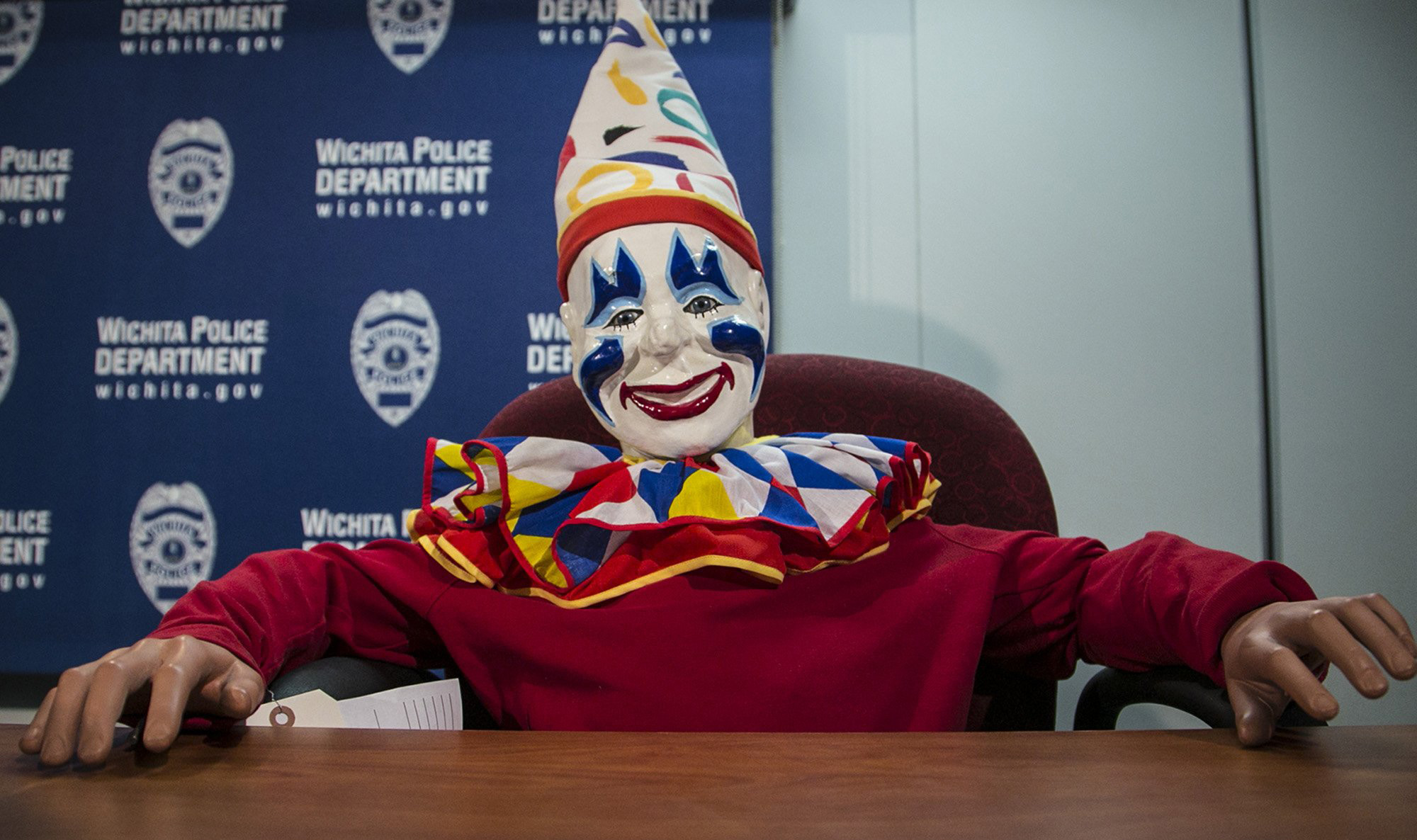 Joyland's organ-playing mascot Louie the Clown appears at a daily police briefing in the Wichita City Hall police headquarters, Thursday, Feb. 19, 2015, in Wichita, Kan.