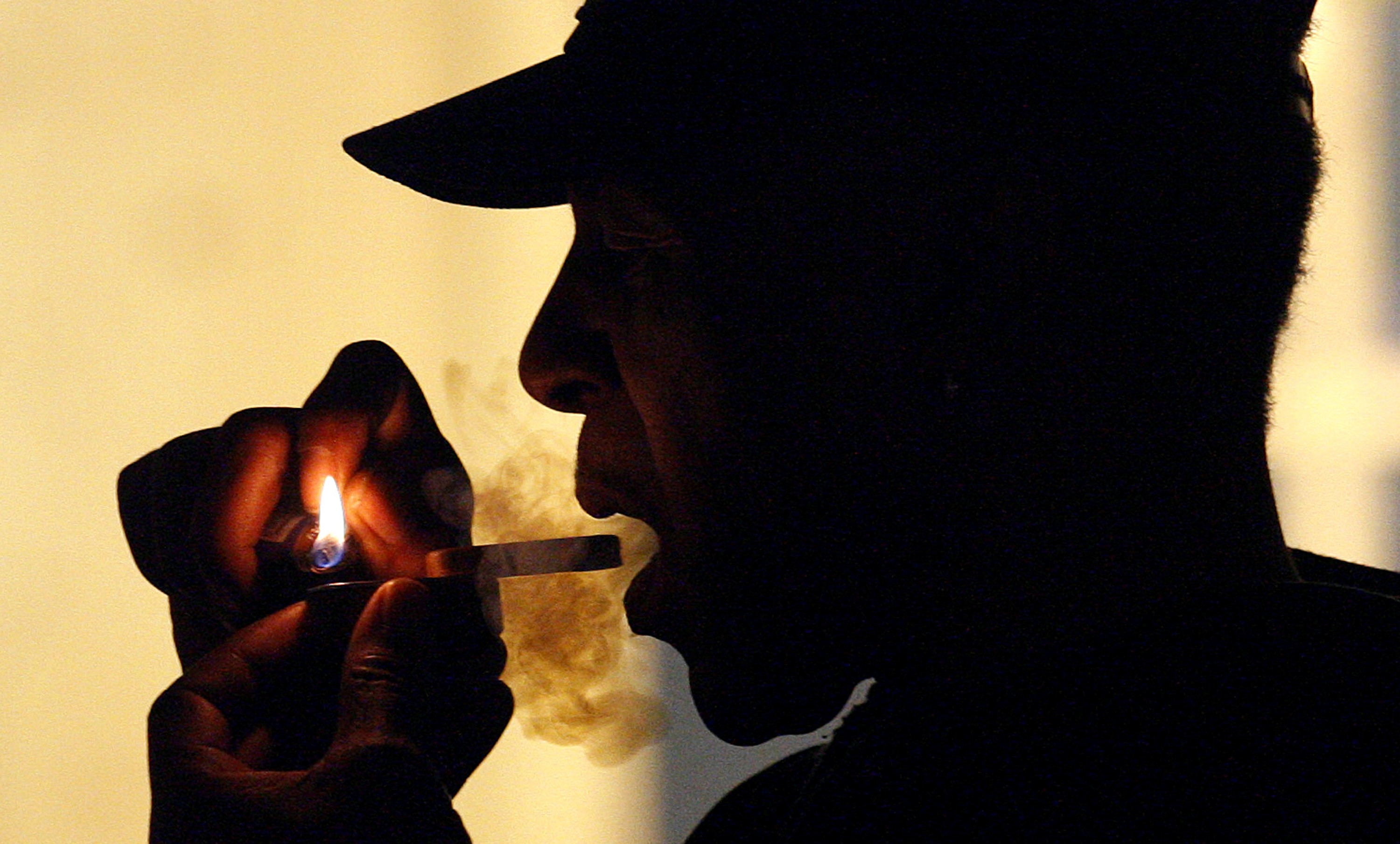 A man is seen smoking medical marijuana during karaoke night at the Cannabis Café, in Portland, Ore. in 2011.