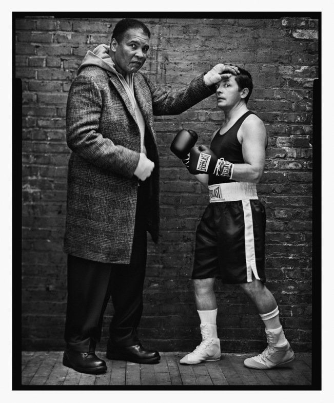Ali and Michael J. Fox, New York City, 2004                                                              Mark Seliger:  After the shoot [above], the champ was signing a Neil Leifer print of his legendary fight with Sonny Liston that I have hanging in my house. He wrote, 'Love is the net where hearts are caught like fish' across the bottom of the print, and when he made a mistake, he would fix it by inking in the miswritten letter with a big black heart.                                                                Mark Seliger is a renowned portrait photographer.