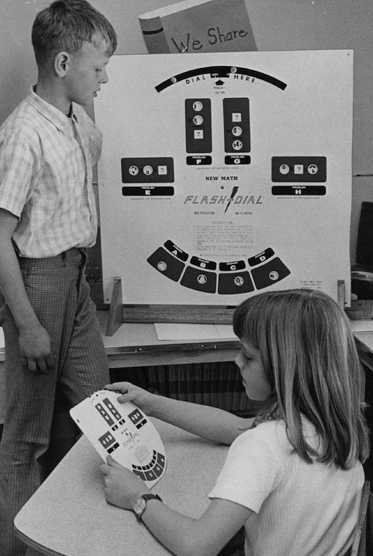 Craig Larsen and Debra Morris use new math Flash-Dial in 1970                     Craig Larsen and Debra Morris use new math Flash-Dial, a learning device, that allows students to set their own pace in airthmetic. Individual instruction program at Montview requires several such aids.                                          Credit: Denver Post