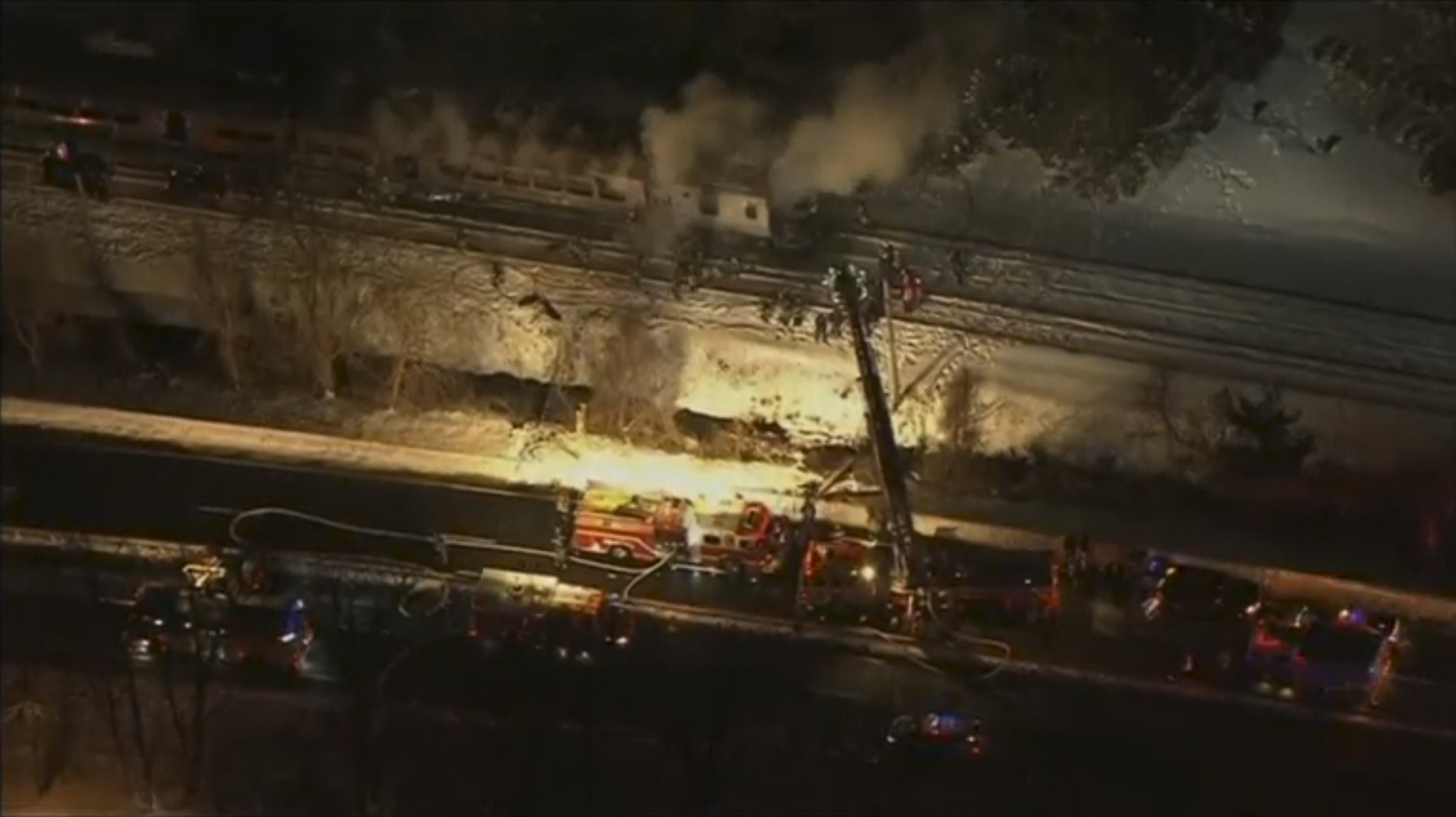 A still image captured from WNBC-TV aerial video shows first responders battling a fire on a New York City Metro-North train following an accident near Valhalla, N.Y. on Feb. 3, 2015.