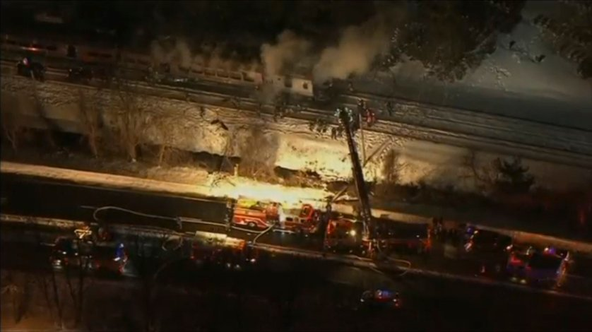 A still image captured from WNBC-TV video shows first responders battling fire on a New York City -Metro-North train following an accident near Valhalla New York