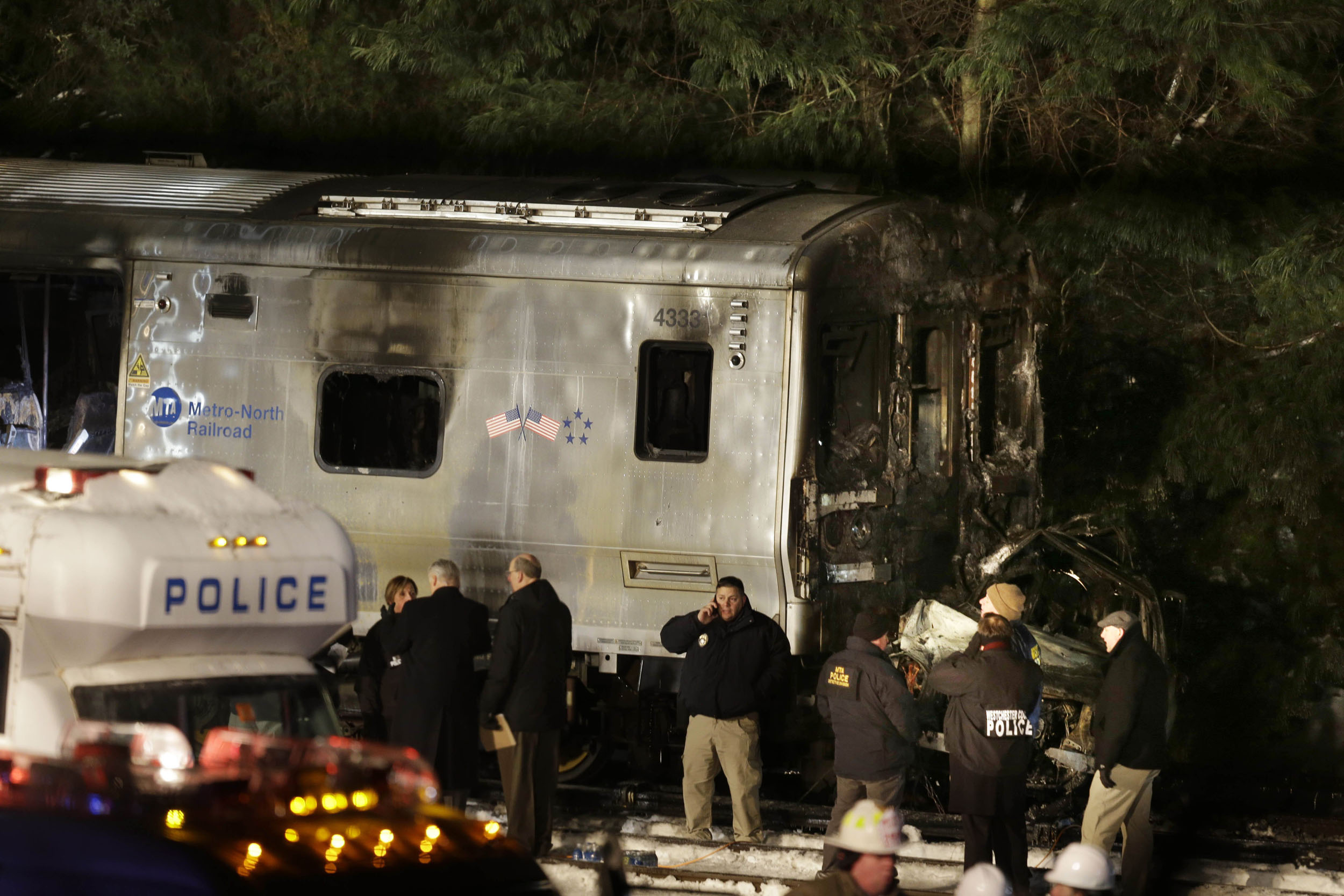 Emergency personnel work at the scene of a Metro-North Railroad passenger train and vehicle accident in Valhalla, N.Y., Feb. 3, 2015.