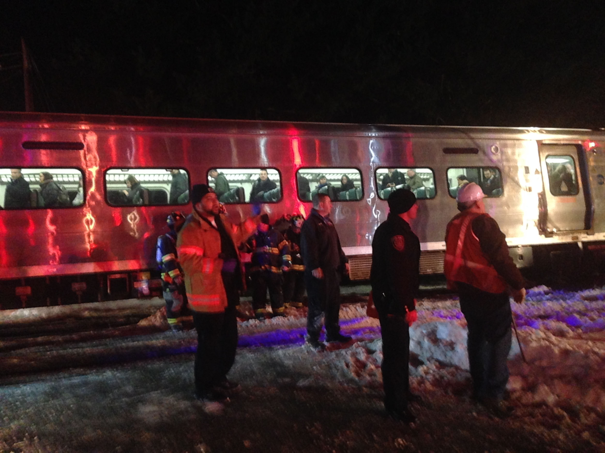 First responders work at the scene of a train accident on in Valhalla, N.Y. on Feb. 3, 2015.