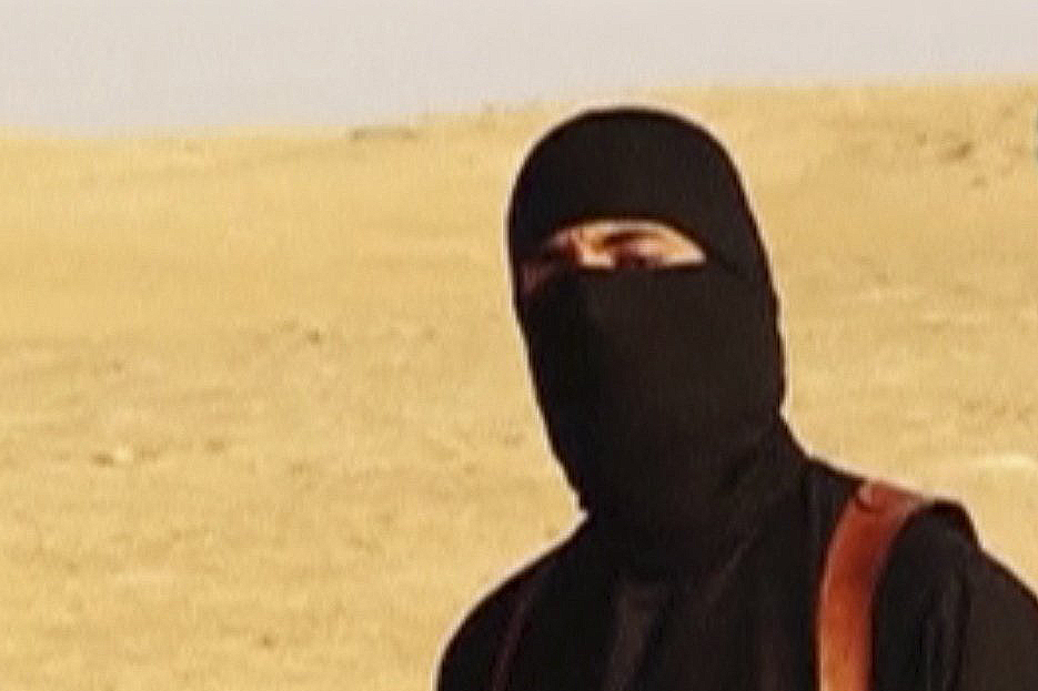 The ISIS militant, who has been identified as a Briton named Mohammed Emwazi, seen in a propaganda video.
