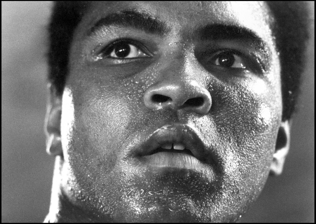 Ali's mountaintop training camp in Deer Lake, Pa., 1977                               Michael Brennan:  I had attempted this picture on numerous previous occasions, with no success. Ali and I both needed to be precisely where we were at that exact moment for this image to exist. As he prepared for his 1977 collision with the dangerous and fearsome puncher Earnie Shavers, it all came together in one moment for this ever inspiring image. The picture was taken at Muhammad's mountaintop training camp at Deer Lake during his preparation for his Sept. 29 bout with Shavers held at New York City's Madison Square Garden. It was probably taken on Sept. 17. Ali was down on most of the judges' cards going into the last rounds. However, he produced a masterful final three minutes to pull off a controversial victory. Many years later, he ran his right index finger over the photo and whispered to no one in particular, 'I can feel the texture of all the sweat and hard work. I can feel my life.' The portrait, titled 1977, is now part of the permanent collection of the National Portrait Gallery in Washington, D.C.  Michael Brennan is a documentary and celebrity photographer.