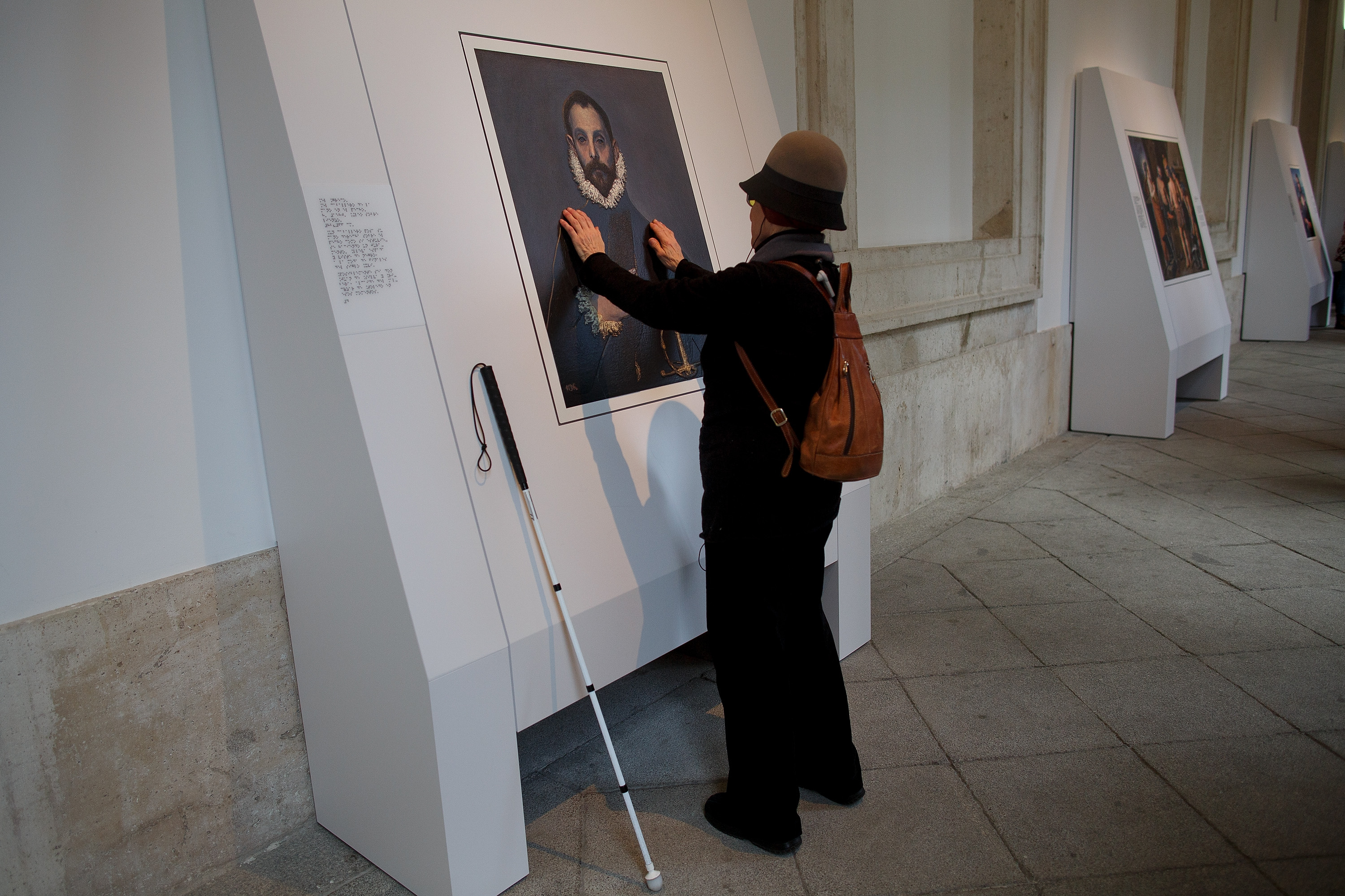 A blind person feels with her hands a copy of 'The gentleman with his hand on his chest' of El Greco at The Prado Museum on Feb. 10, 2015 in Madrid.