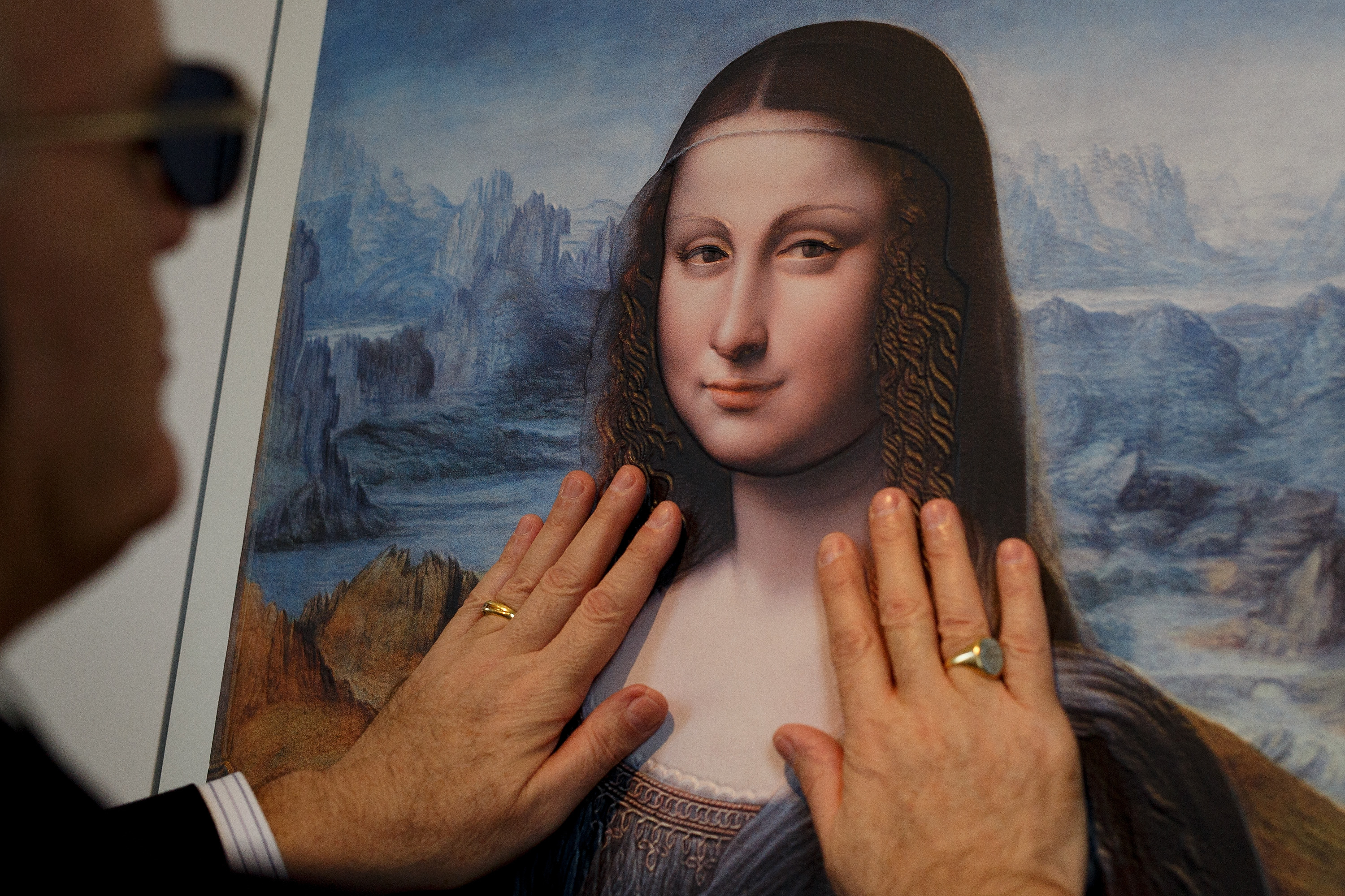 A blind person feels with his hands a copy of 'The Mona Lisa  at The Prado Museum on Feb. 10, 2015 in Madrid.