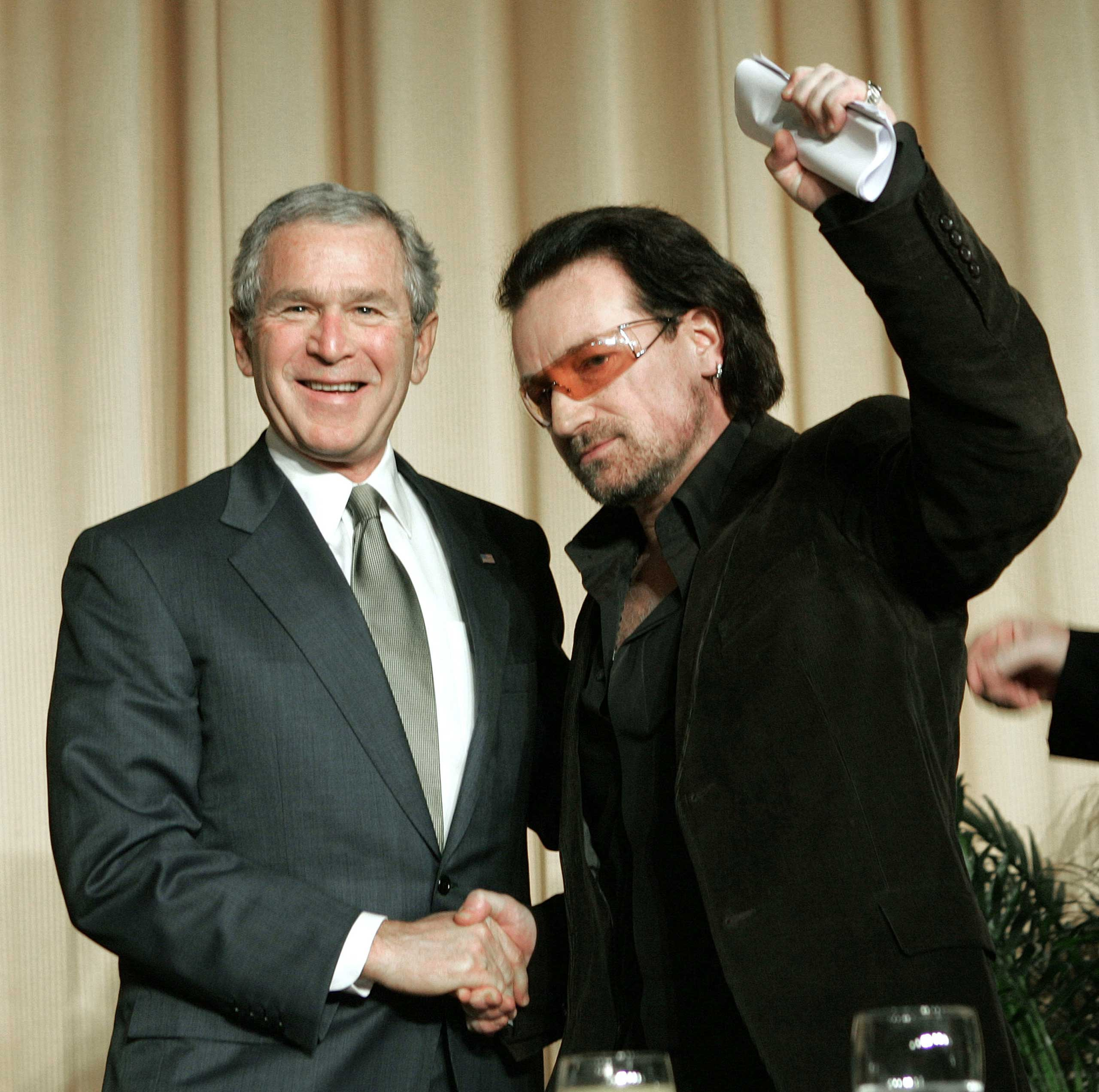 President George W. Bush shakes hands with U2 frontman Bono, who spoke at the 2006 National Prayer Breakfast.