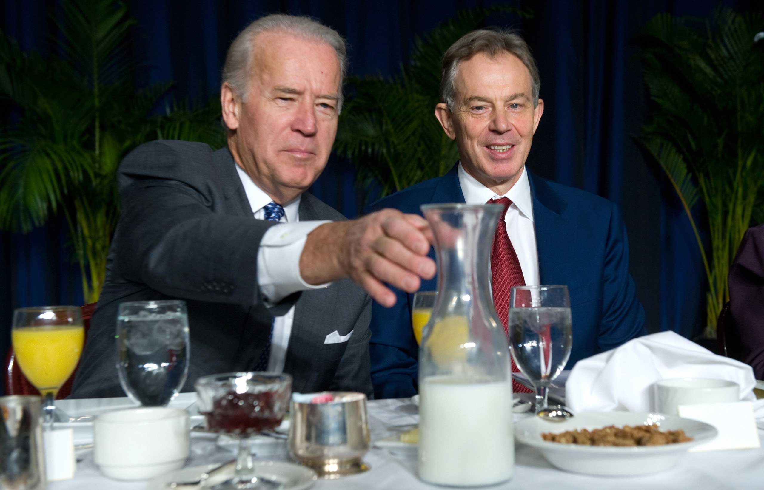 Vice President Joe Biden reaches for milk while sitting next to former Prime Minister Tony Blair at the 2009 National Prayer Breakfast.