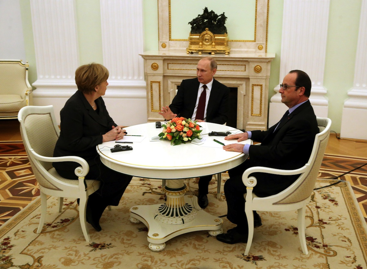 Russian President Vladimir Putin (C) attends a meeting with German Chancellor Angela Merkel (L) and French President Francois Hollande (R) on Feb. 6, 2015 in Moscow, to discuss the conflict in Ukraine