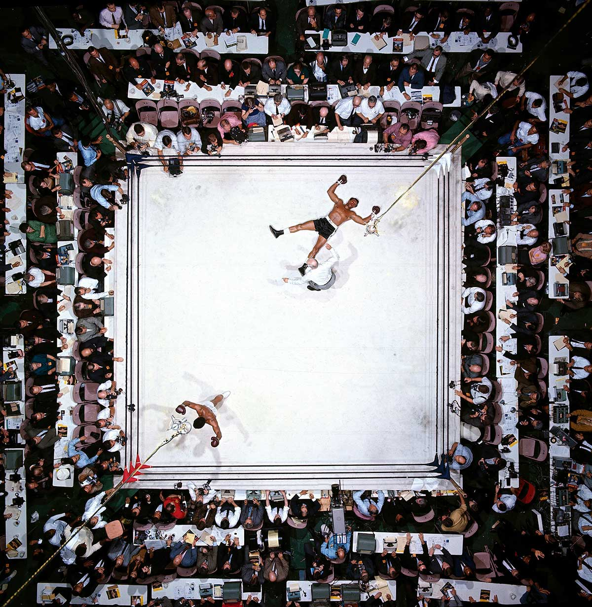 Muhammad Ali vs. Cleveland Williams at the Astrodome, Houston, 1966                               Neil Leifer:   I think this is the best picture I ever made. It's the only picture of mine that I have in my home. I could go on for a long time about the technical aspects of the shot, how I studied the Astrodome, planned the photo for weeks before the fight, pictured the shot in my head, rigged up the remote trigger that I used to get the shot from above while I was physically down at ringside shooting the fight — but what makes this so special to me is that it's as close as I've ever gotten to a perfect shot. Ali, Williams, the referee, the reporters, the symmetry, the drama — it's the one photograph I've taken where, looking back, I'd change nothing.                                                                NOTE: Leifer is visible here, wearing a light blue shirt and seated near the top along the left-hand side of the ring, with his camera resting in front of him.Neil Leifer is a photographer for Sports Illustrated.