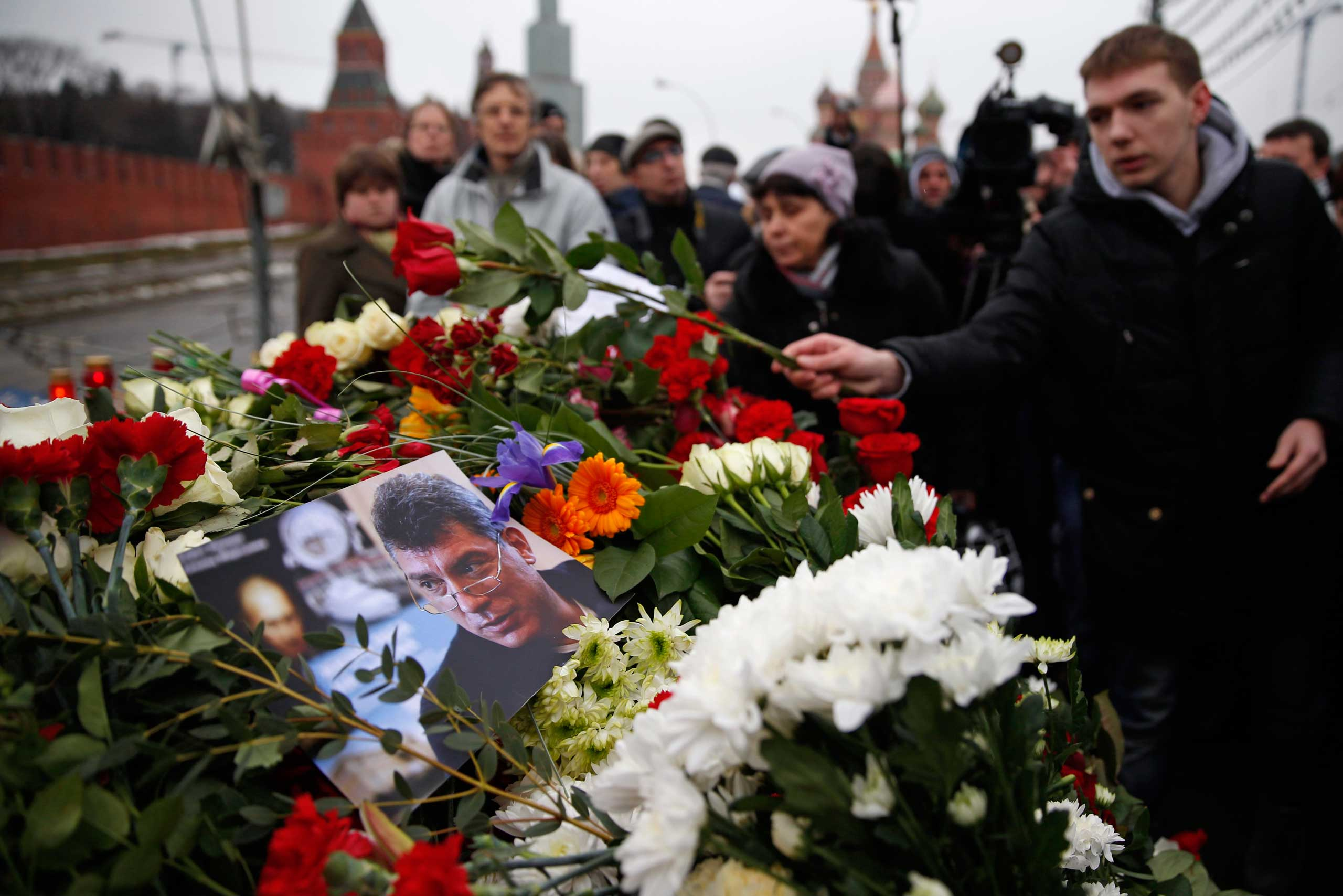 People lay flowers at the place where Boris Nemtsov, a charismatic Russian opposition leader and sharp critic of President Vladimir Putin, was gunned down, at Red Square in Moscow, Russia, Feb. 28, 2015.