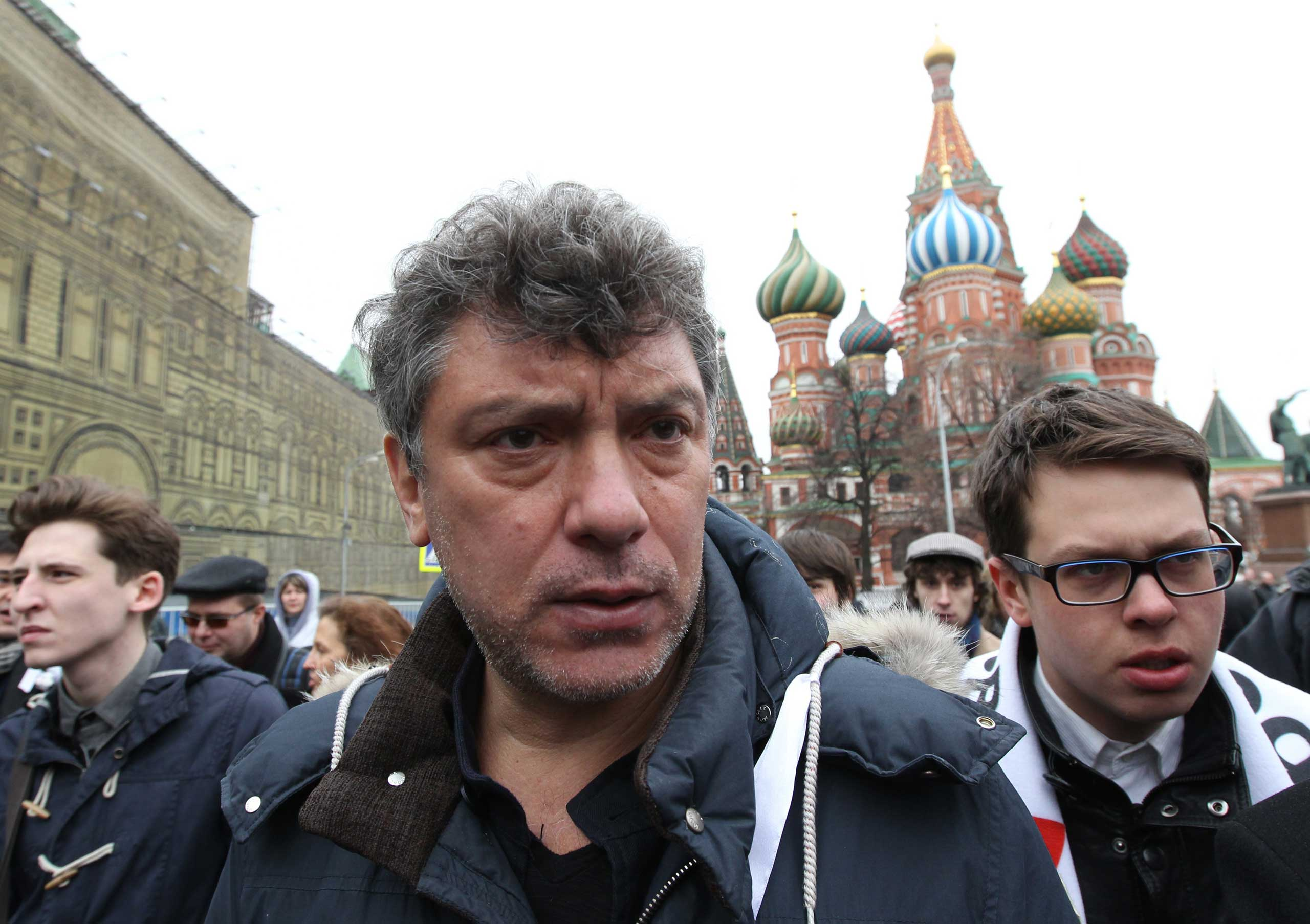 Boris Nemtsov, center, and other opposition activists attend a rally at Red Square on April 8, 2012 in Moscow.