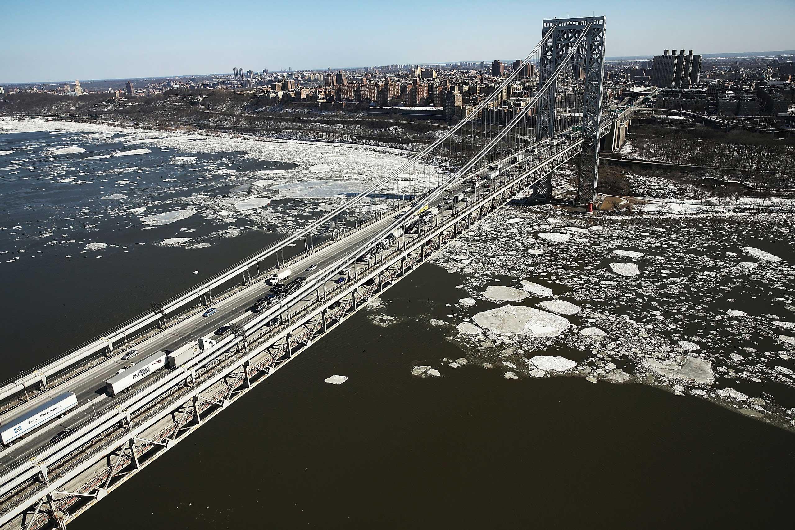 Ice flows along the Hudson River near the George Washington Bridge on Feb. 20, 2015 in New York City.