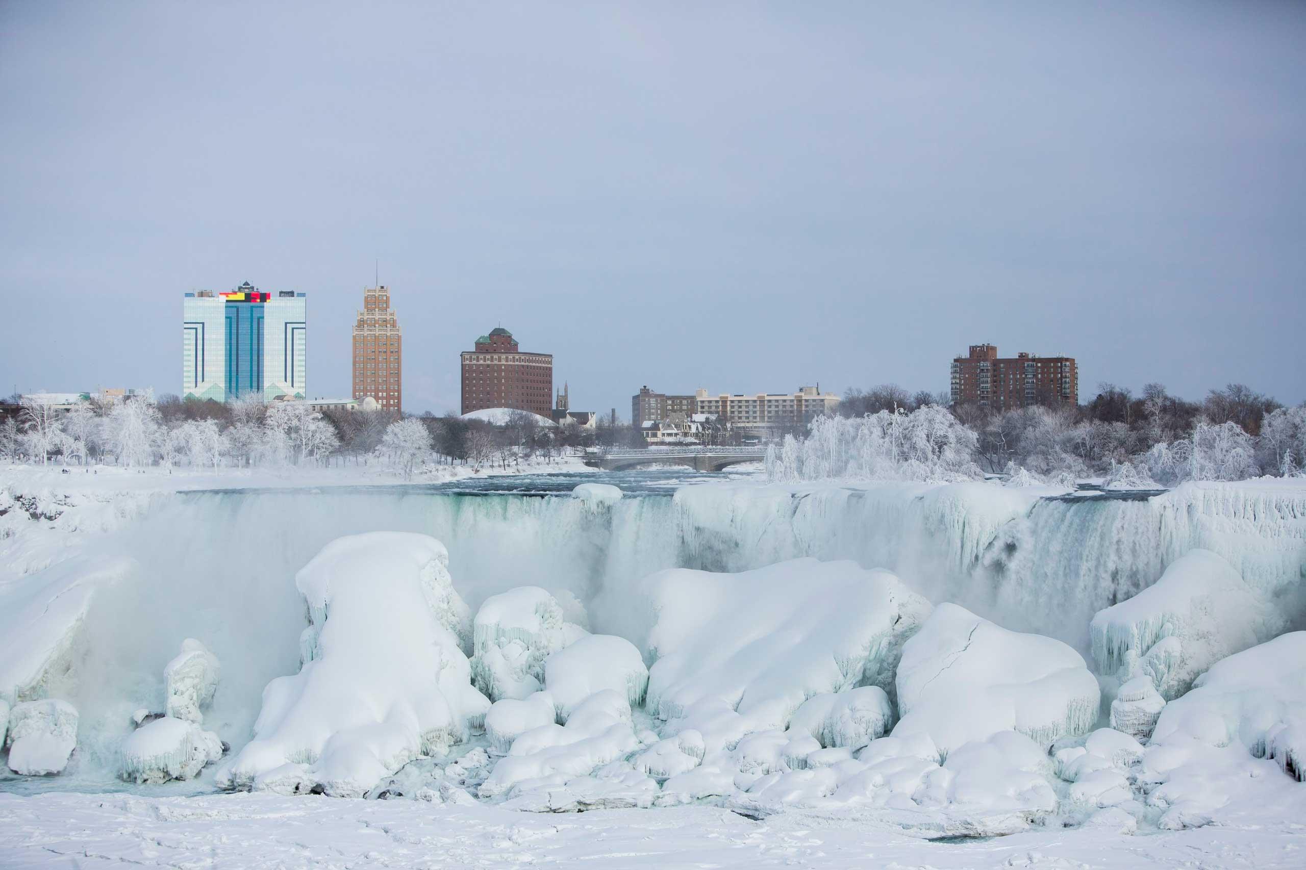 A partially frozen American Falls in sub freezing temperatures is seen in Niagara Falls, Ontario, Canada, Feb. 17, 2015.