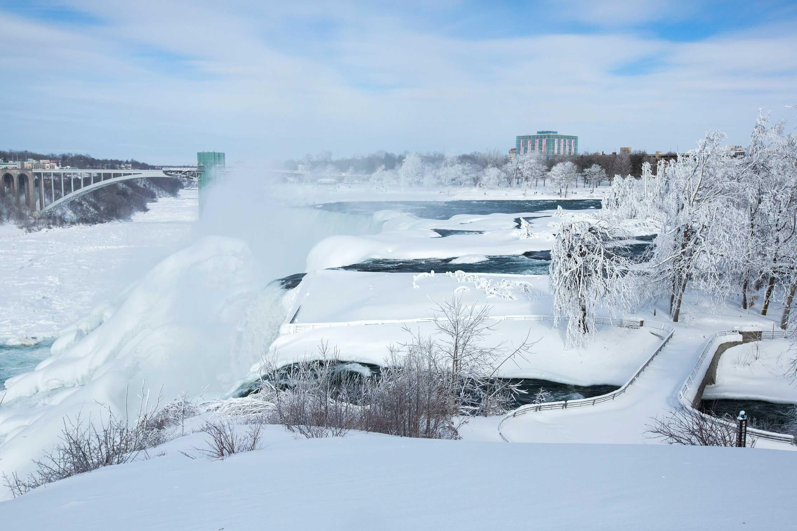 A snow-covered landscape is seen around the frozen Niagara Falls in Niagara Falls, N.Y. Feb.17, 2015.