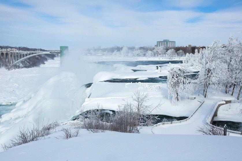 A snow-covered landscape is seen around the frozen Niagara Falls in Niagara Falls, Feb.17, 2015.