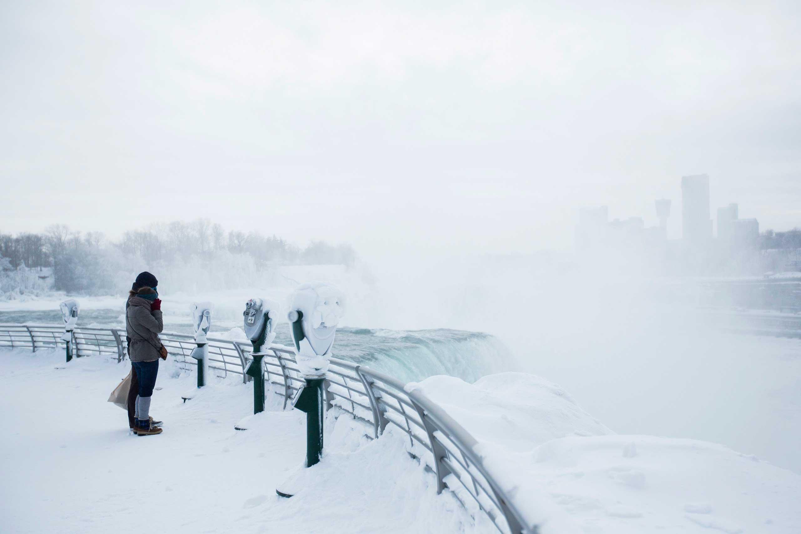 Visitors view frozen Niagara Falls in Niagara Falls, N.Y., Feb. 17, 2015.