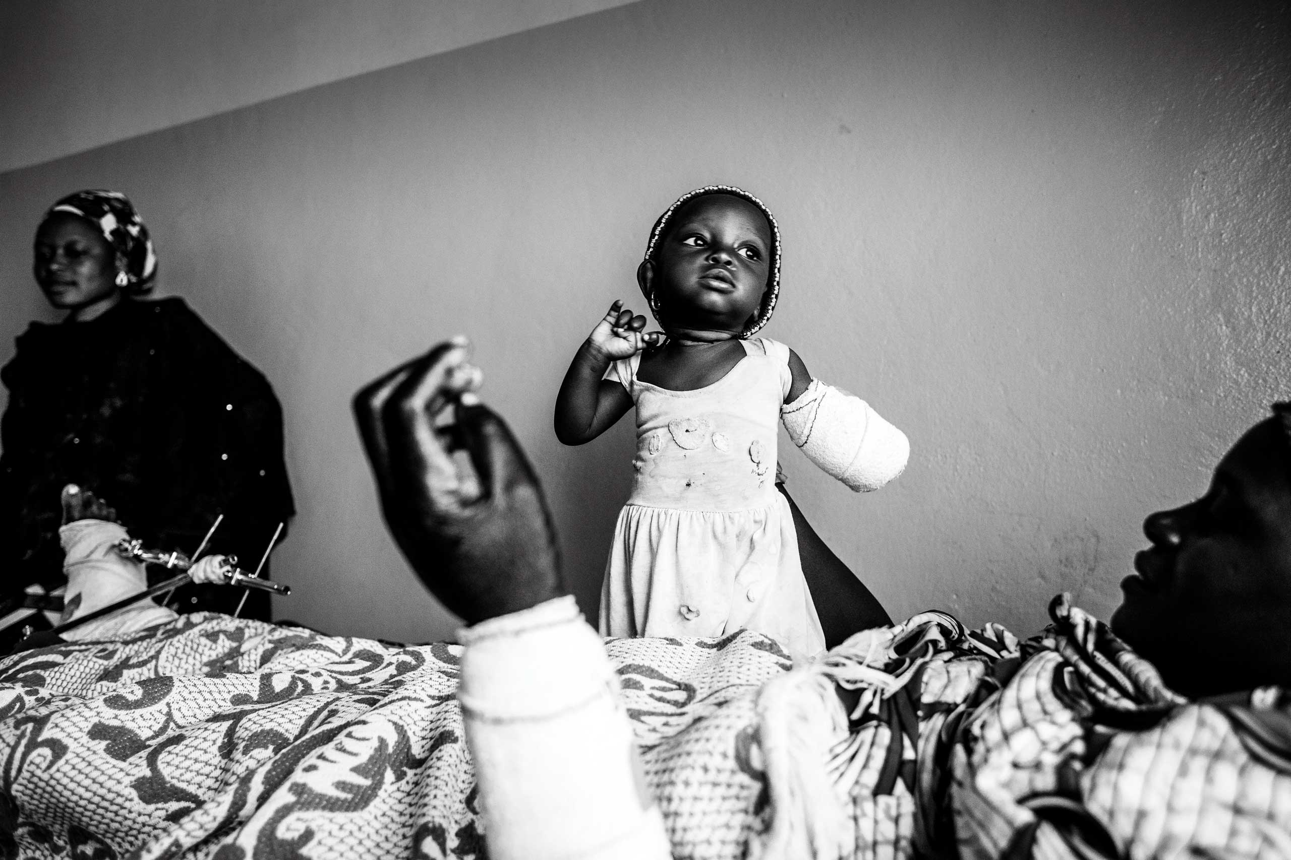 The Washington Post In Sight: The enemy within: A closer look at survivors of Boko Haram attacks across Northern NigeriaEight month old Afiniki lost her left arm in a Boko Haram attack on the Christian village of Chakawa in Jos, Nigeria, Jan. 2014.