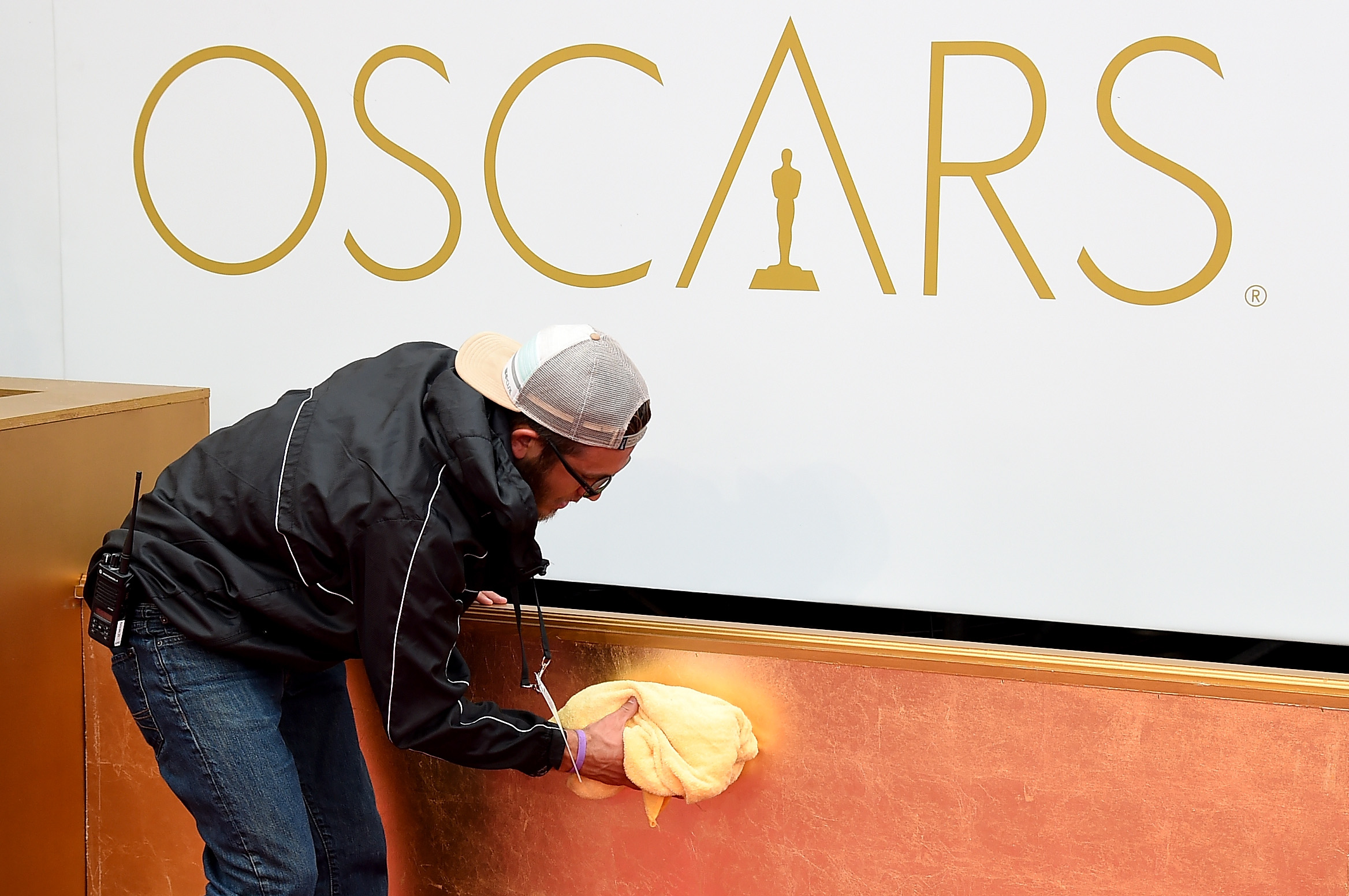 A member of the crew works on the red carpet of the 87th Annual Academy Awards at Hollywood & Highland Center on Feb. 22, 2015 in Hollywood.