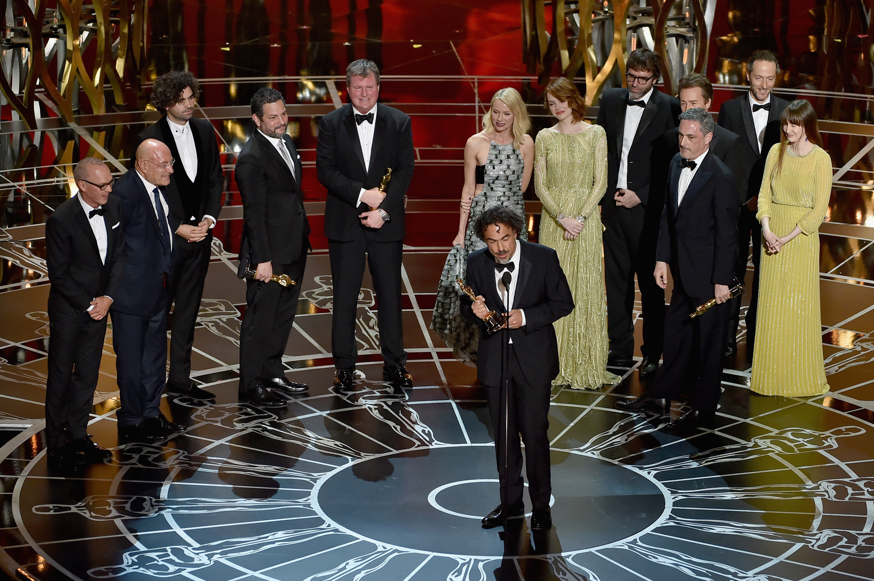 Director Alejandro Gonzalez Inarritu (C) with cast and crew accept the Best Picture award for 'Birdman' onstage during the 87th Annual Academy Awards at Dolby Theatre on February 22, 2015 in Hollywood, California.