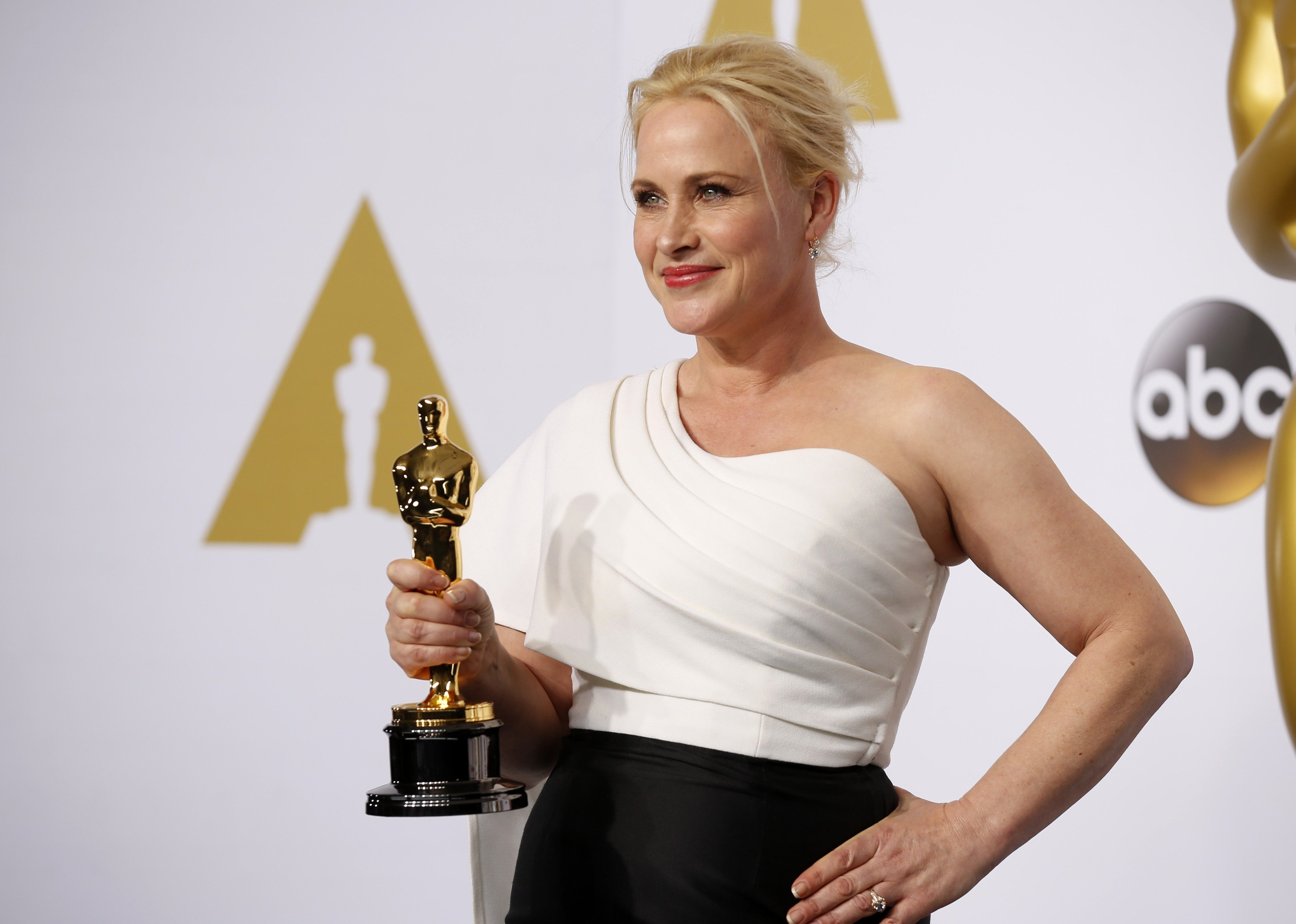 Patricia Arquette, best supporting actress winner for her role in  Boyhood,  poses with her award                      during the 87th Academy Awards in Hollywood on Feb. 22, 2015.