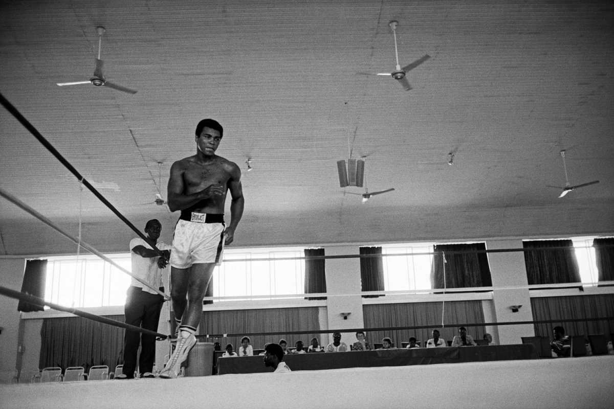 Ali training in Kinshasa, Zaire                               Abbas:   Muhammad Ali during a training bout in Kinshasa, Zaire. Ali is lean and fast, a magnificent athlete in his full mature glory. I cannot help but wonder if his running around the ring is not also an exercise in deliberate disinformation, a trick to disorient his adversary. Before the match, Ali had everyone believing he would 'float like a butterfly, sting like a bee.' He did exactly the opposite. He played the ropes, letting Foreman exhaust himself by throwing punches Ali took in because he had hardened his body during training. On that celebrated night, Ali did not win with his fists only. He won with his mind. My photo suggests the alliance of the body with the mind.  Abbas is a photographer represented by Magnum.
