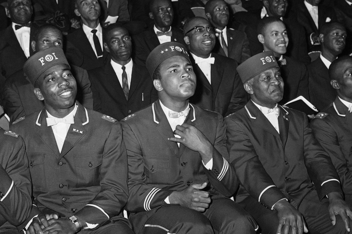 """Muhammad Ali listens intently to his leader, Elijah Muhammad,  Chicago,  1966                               Maya Angelou:  """"I met Muhammad Ali in Accra, Ghana. I invited him to my house for dinner. He accepted and reminded me that he was a Muslim and ate no pork. I told him I was a Southern black woman who knew how to fry chicken. I told a person who works for me that I would like him to help me that evening because Muhammad Ali was coming for dinner. I warned him not to mention it to anyone. As the hour approached, I opened my door and heard shouts:  The Greatest! The Greatest! The Greatest  — my block was filled with thousands — and he was. Happy birthday.""""                               Maya Angelou is a renowned author, poet and activist for civil and women's rights."""