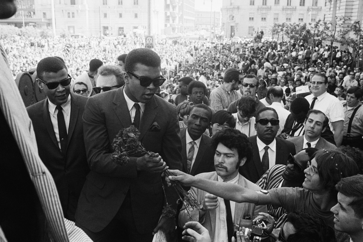Ali during a weeklong protest against the Vietnam War draft in San Francisco, 1968                                                              Tommie Smith:  The blink in his eye when he was socially bound and stripped from his heavyweight boxing title.  Tommie Smith is a former Olympic athlete in track and field.