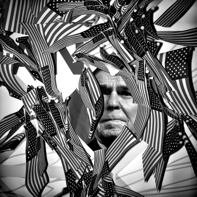 American flags surround a photo of Ronald Regan at the Young Americans for Liberty booth at CPAC on Mar. 8. 2014.