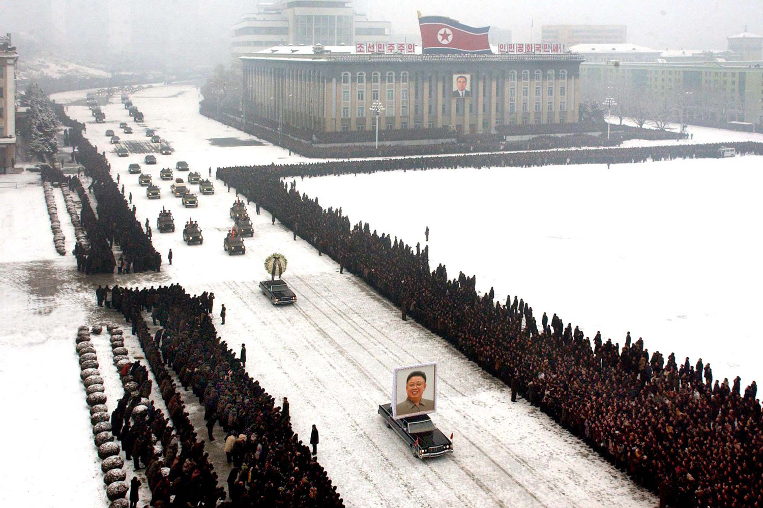 """This <a href=""""http://lightbox.time.com/2011/12/30/the-aesthetics-of-a-dictatorship-north-koreas-photoshopped-funeral"""" target=""""_blank"""">photograph</a> from the funeral procession of Kim Jong Il, taken by the Korean Central News Agency was proven to be digitally altered."""