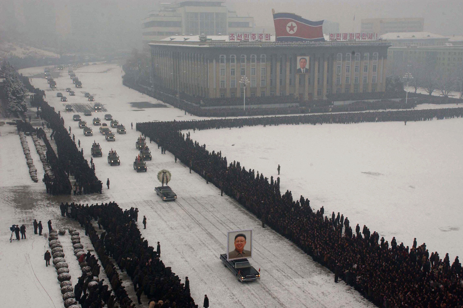 """This is the unmanipulated <a href=""""http://lightbox.time.com/2011/12/30/the-aesthetics-of-a-dictatorship-north-koreas-photoshopped-funeral"""" target=""""_blank"""">photograph</a> from the funeral procession of Kim Jong Il, taken by Kyodo News. an independent Japanese news agency."""