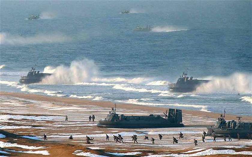 """This <a href=""""http://www.theatlantic.com/photo/2013/03/is-this-north-korean-hovercraft-landing-photo-faked/100480/"""" target=""""_blank"""">photograph</a> from a military exercise in North Korea, released by the Korean Central News Agency, was digitally altered to add extra hovercrafts."""
