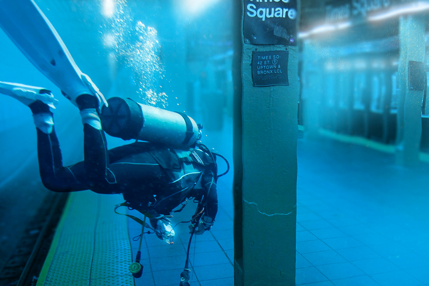 """This photoshopped image of a <a href=""""//www.theatlantic.com/technology/archive/2012/10/sorting-the-real-sandy-photos-from-the-fakes/264243/"""" target=""""_blank"""">Scuba Diver</a> swimming through Times Square in New York City gained attention during Hurricane Sandy."""