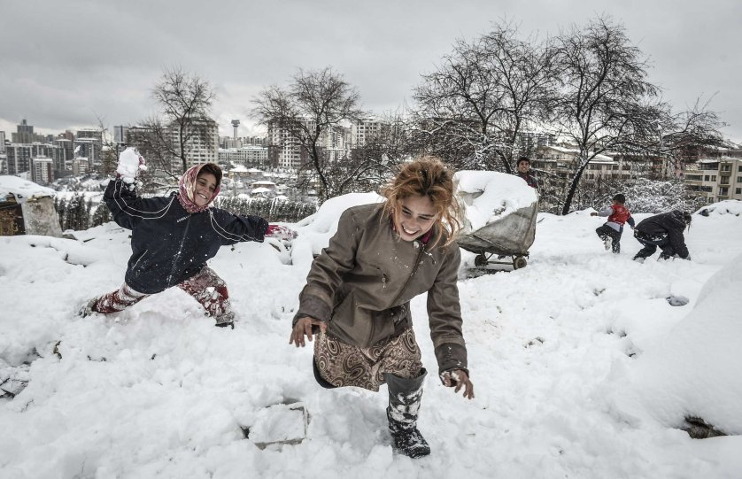 A group of Syrian refugees struggle with cold in Ankara