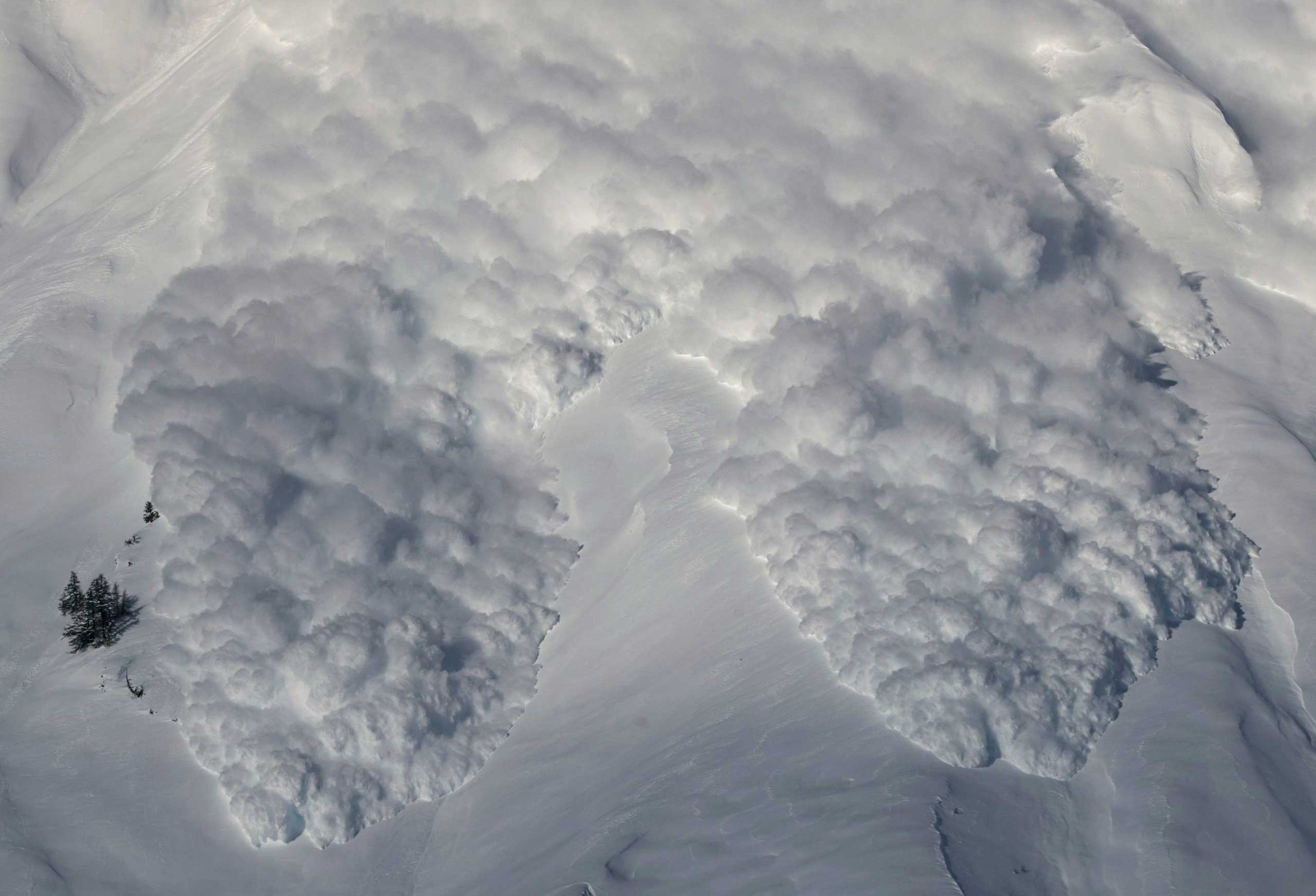 Feb. 3, 2015. An artificially triggered avalanche thunders down a mountain side at the Vallee de la Sionne in Anzere near Sion. The full-scale avalanche dynamics test site provides scientists and engineers of the Swiss Institute of Research of Snow and Avalanches with essential data to understand and model avalanche motion.