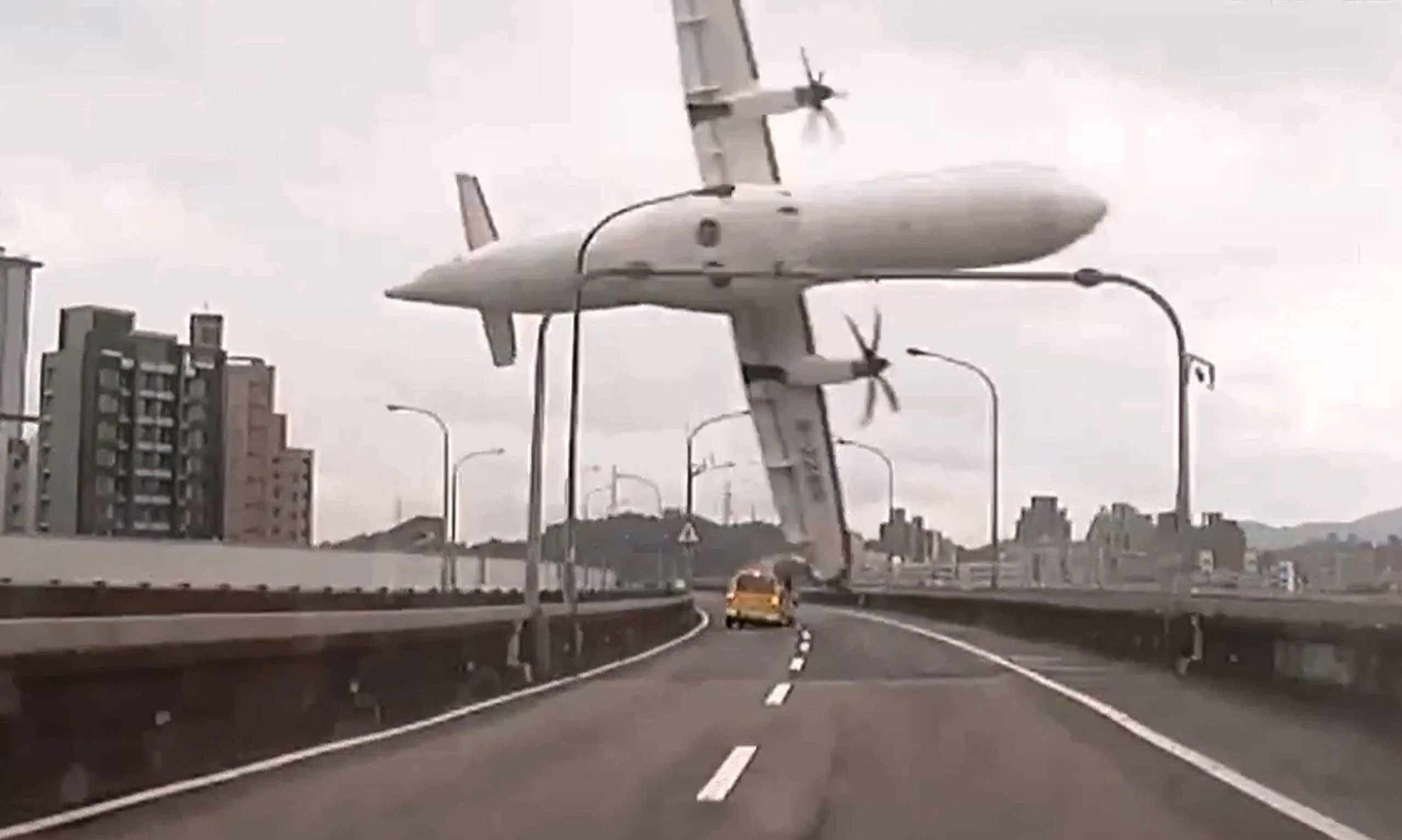 Feb. 4, 2015. This screen grab taken from video provided courtesy of TVBS Taiwan shows a TransAsia ATR 72-600 turboprop plane carrying 58 passengers clipping an elevated motorway and hitting a taxi before crashing into the Keelung river outside Taiwan's capital Taipei.