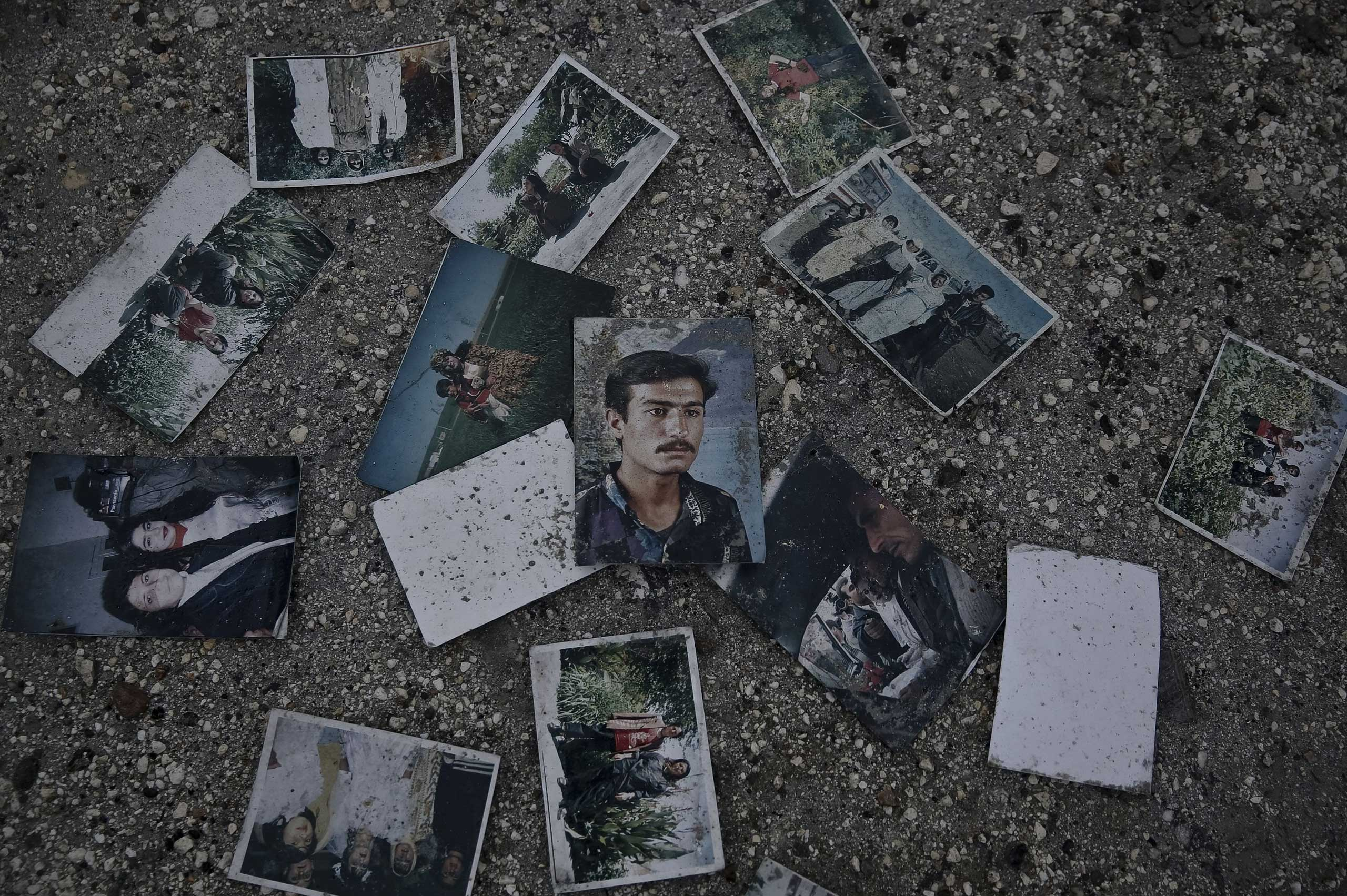 Jan. 31, 2015. Photographs of residents are seen scattered in the ruins of the Syrian border town of Kobane. At least 80 percent of town is destroyed by the suicide bombers of ISIS and airstrikes by the international anti-ISIS coalition.