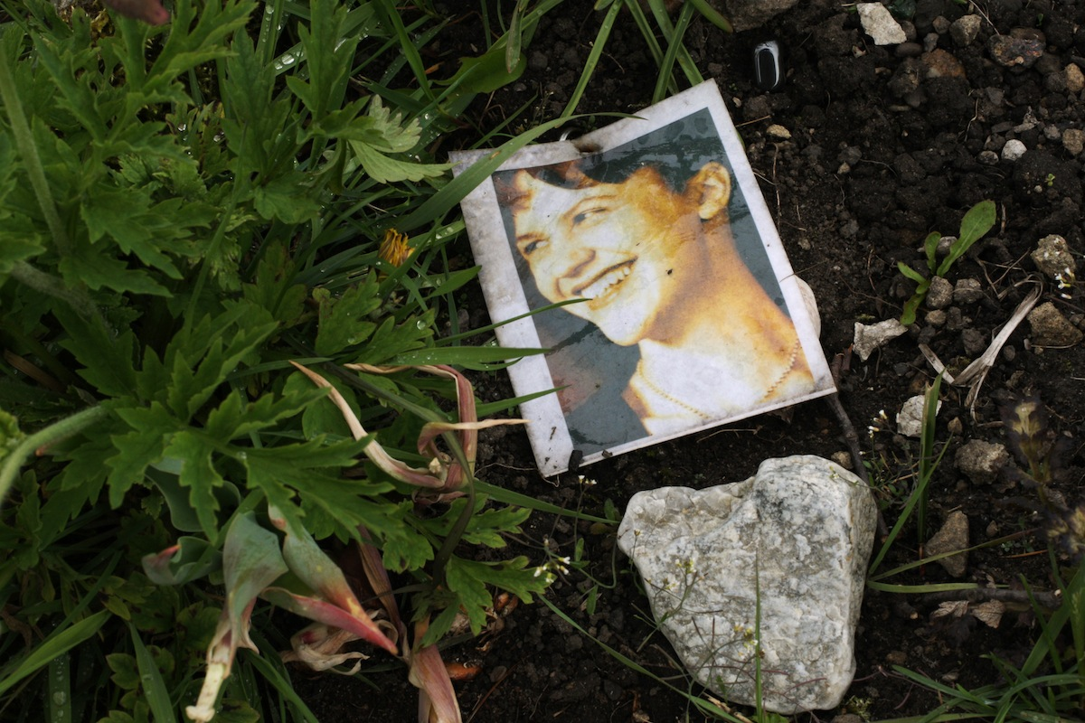 A photograph of Sylvia Plath (1932 - 1963) on her grave at St Thomas a Beckett churchyard, Heptonstall, West Yorkshire, May 5, 2011.