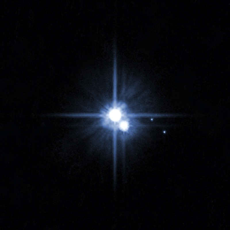 This undated image taken by the Hubble telescope shows Pluto and its moons: Charon, Nix, and Hydra.