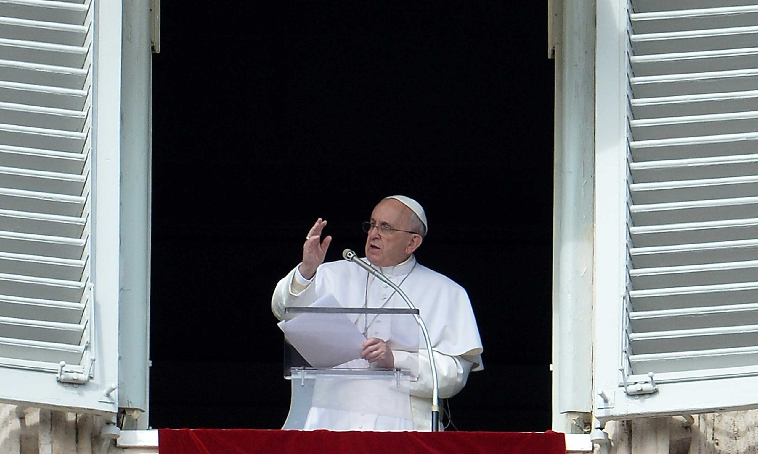 Pope Francis addresses the crowd from the window of the apostolic palace overlooking Saint Peter's square during his Angelus prayer on Feb. 22, 2015 at the Vatican.