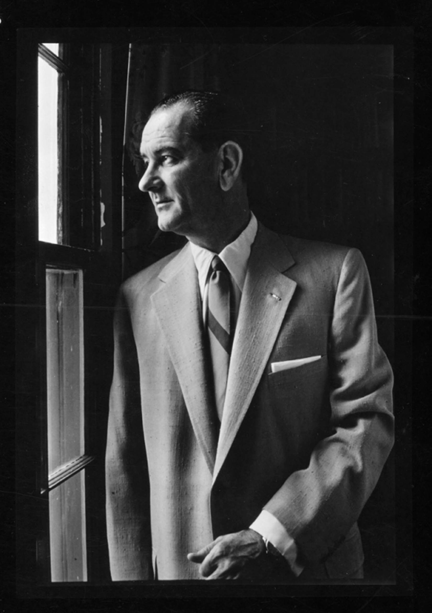 September, 1955. Lyndon B. Johnson, half length portrait, left profile, looking out a window.