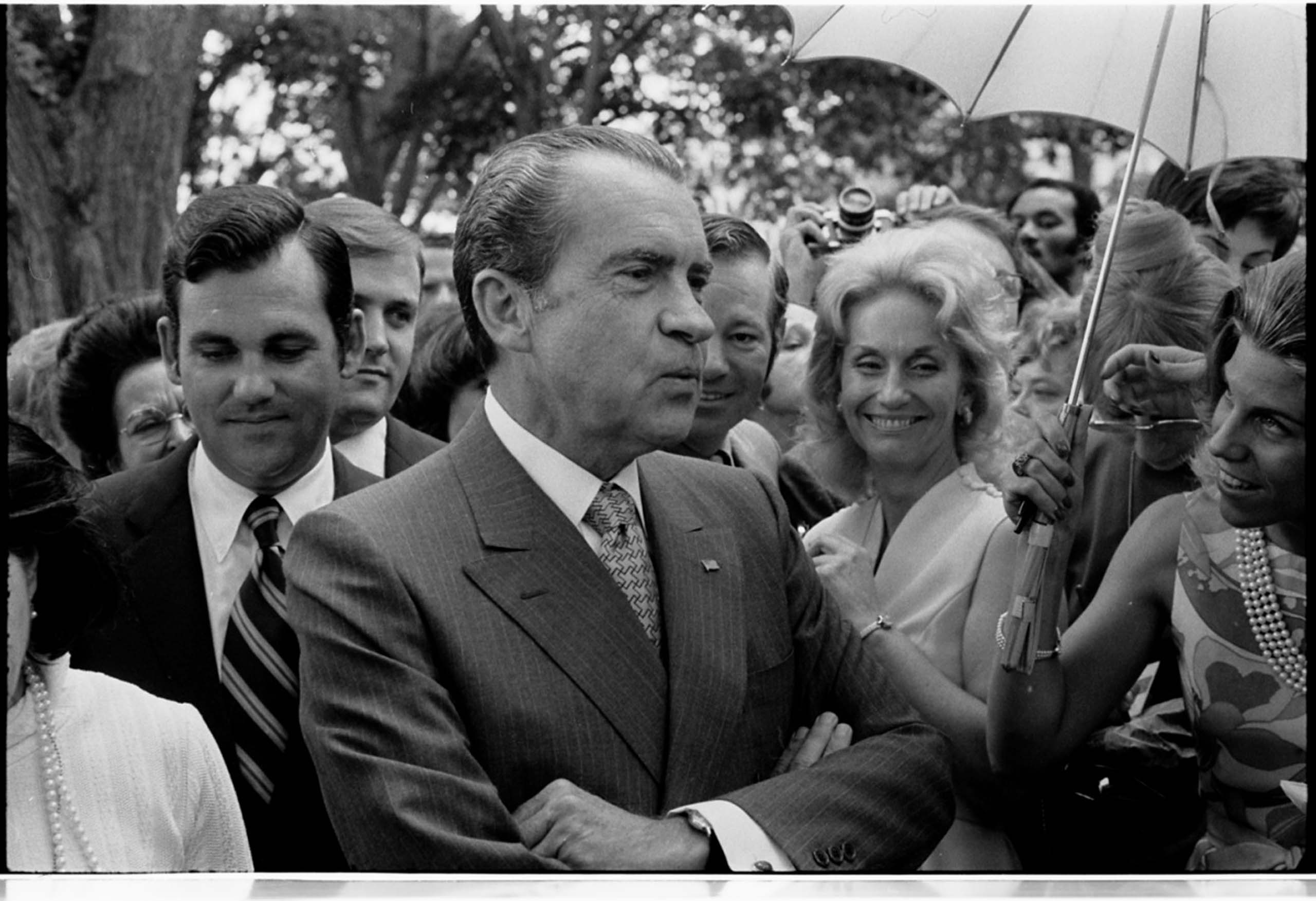 June 12, 1971. President Richard Nixon standing in a crowd of people at daughter Tricia Nixon's wedding at the White House.