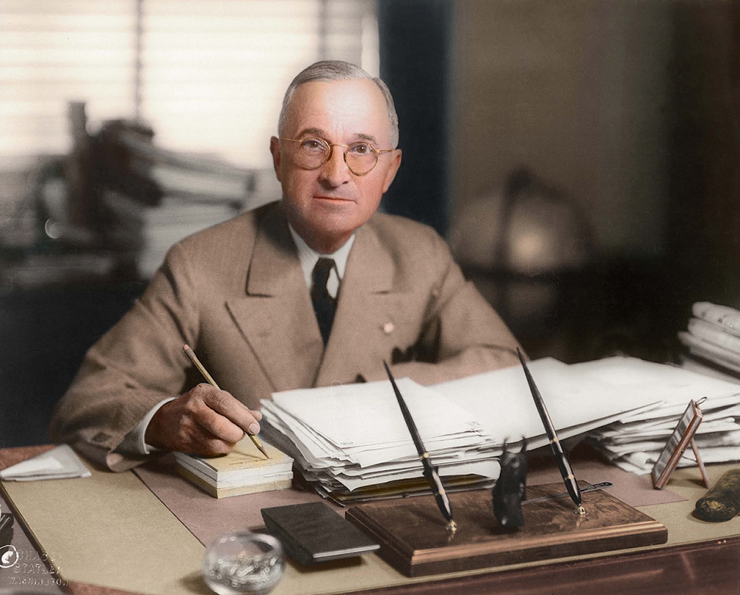 c. April 19, 1945. Harry Truman, half-length portrait, seated at desk, facing front, holding pencil.                                    <i>Ranked #9 in SRI survey of U.S. Presidents.</i>