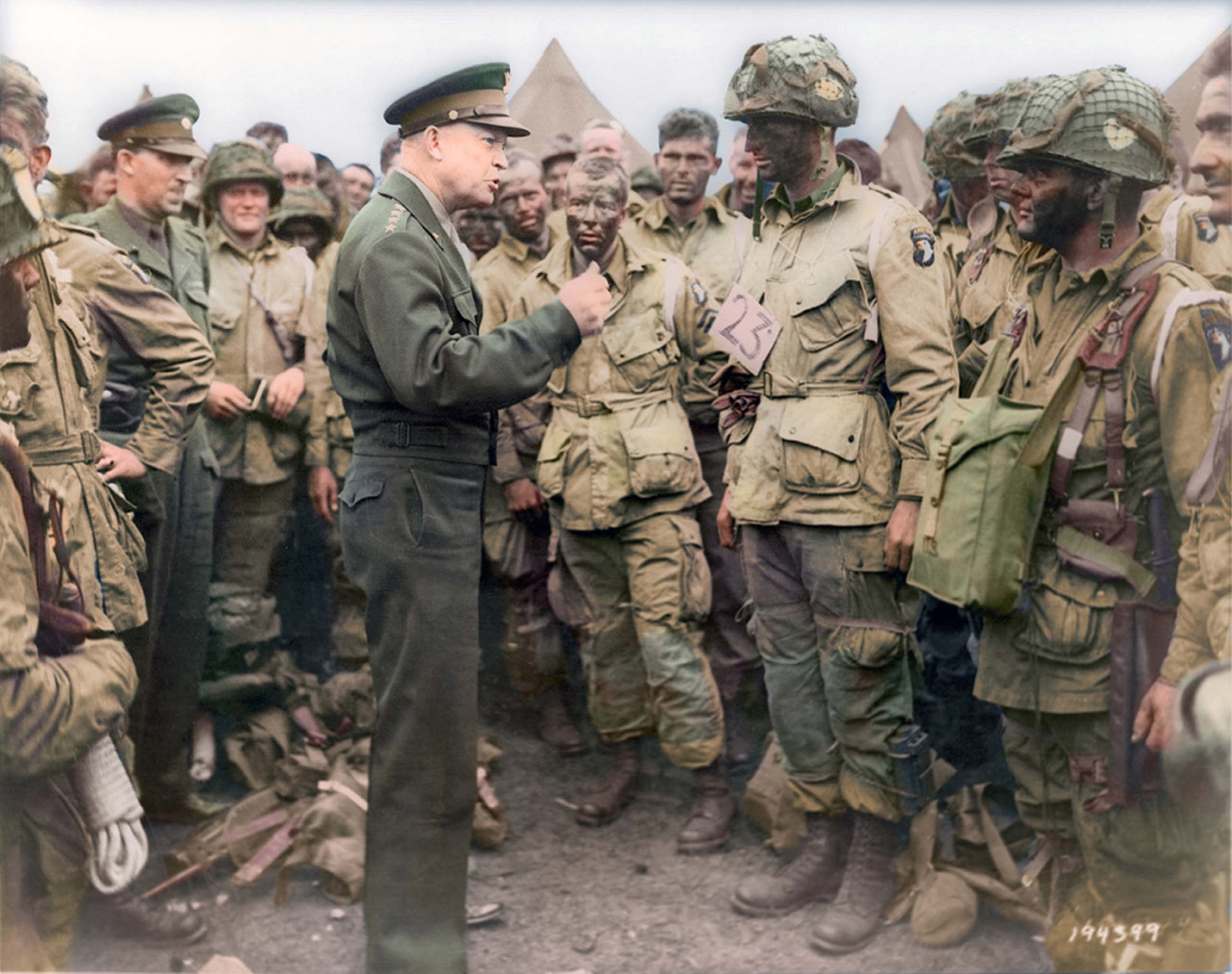 "June 5, 1944. General Dwight D. Eisenhower gives the order of the day, ""Full victory--nothing else"" to paratroopers somewhere in England, just before they board their airplanes to participate in the first assault in the invasion of the continent of Europe.                                   <i>Ranked #10 in SRI survey of U.S. Presidents.</i>"